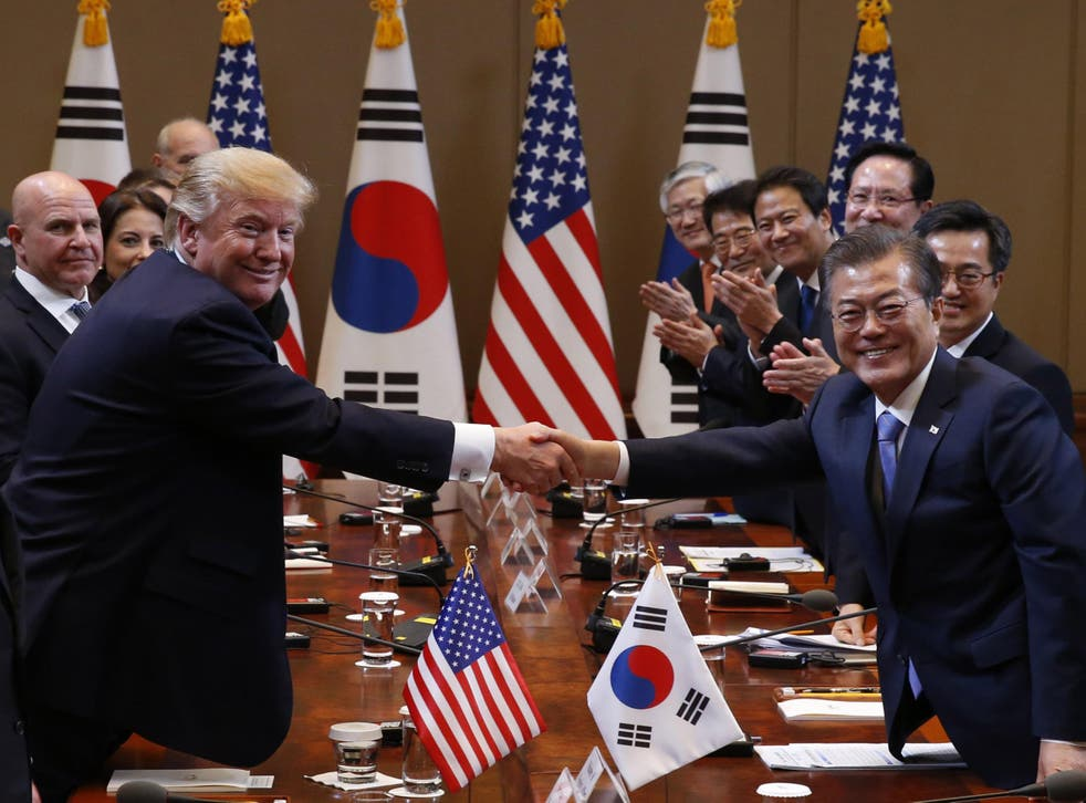 Trump and South Korean President Moon Jae-in shake hands before their summit meeting in Seoul