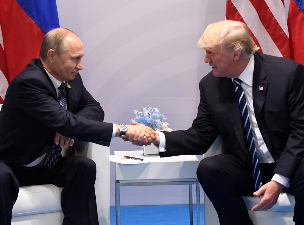 Donald Trump and Vladimir Putin shake hands during a meeting on the sidelines of the G20 Summit in Hamburg, Germany