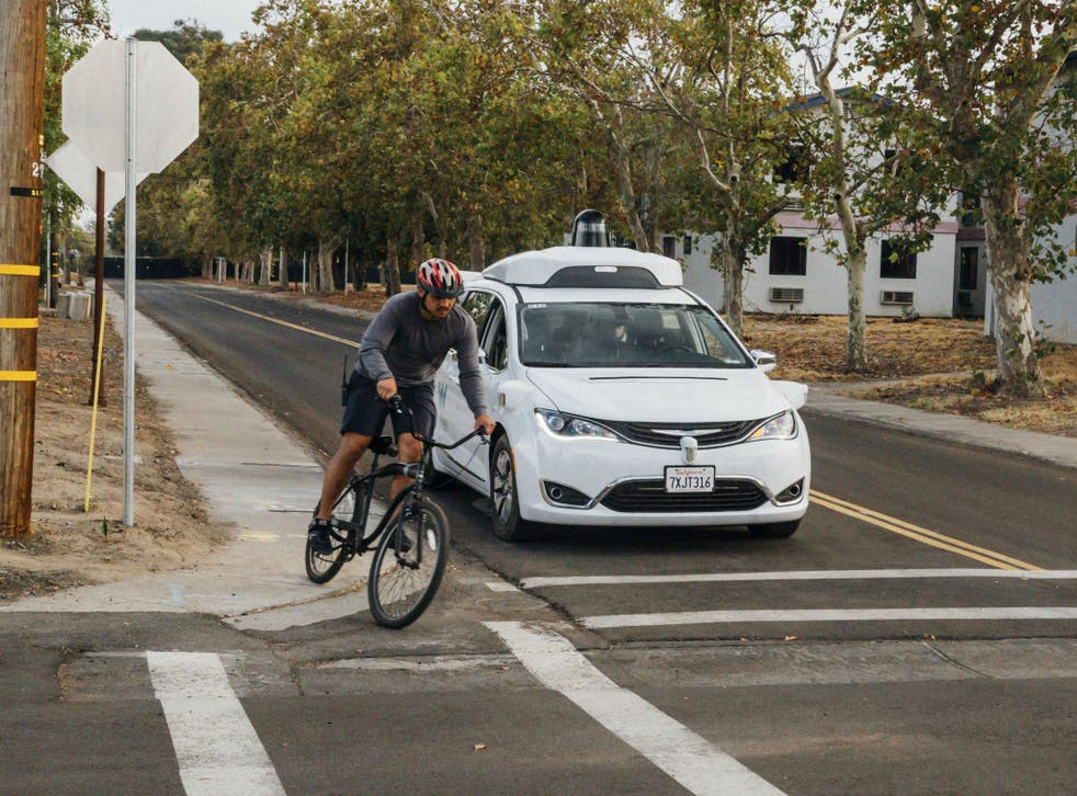 A minivan equipped with Waymo's self-driving car technology is tested at Waymo's facility in Atwater, Calif on Sunday, Oct. 29, 2017.