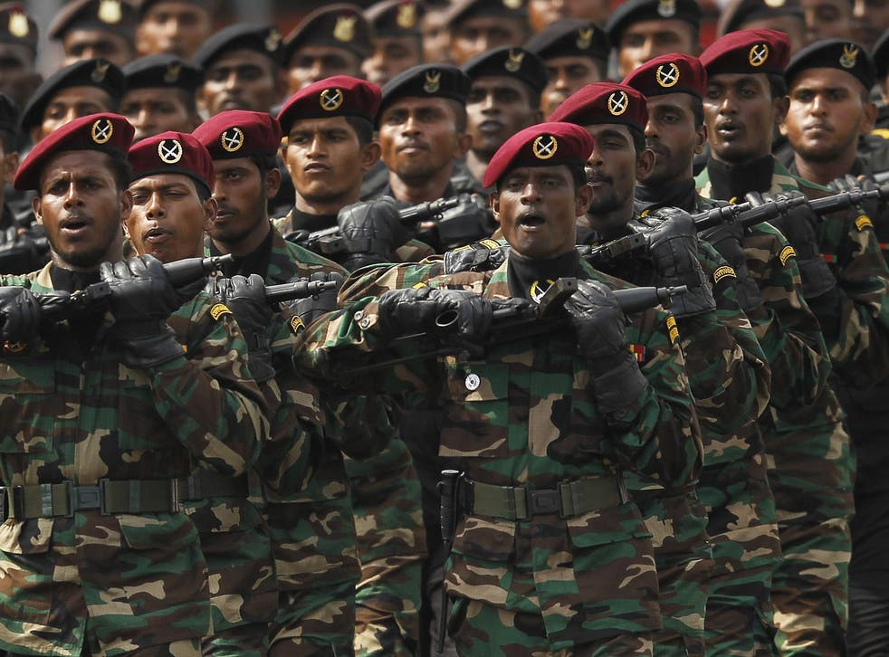 Sri Lankan army commandos march during a War Victory Parade in Colombo in 2013, marking the anniversary of the conflict's conclusion