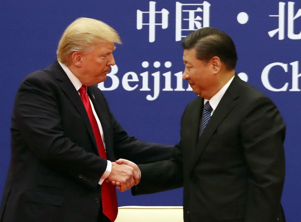 President Donald Trump, left, and Chinese President Xi Jinping during a business event at the Great Hall of the People in Beijing