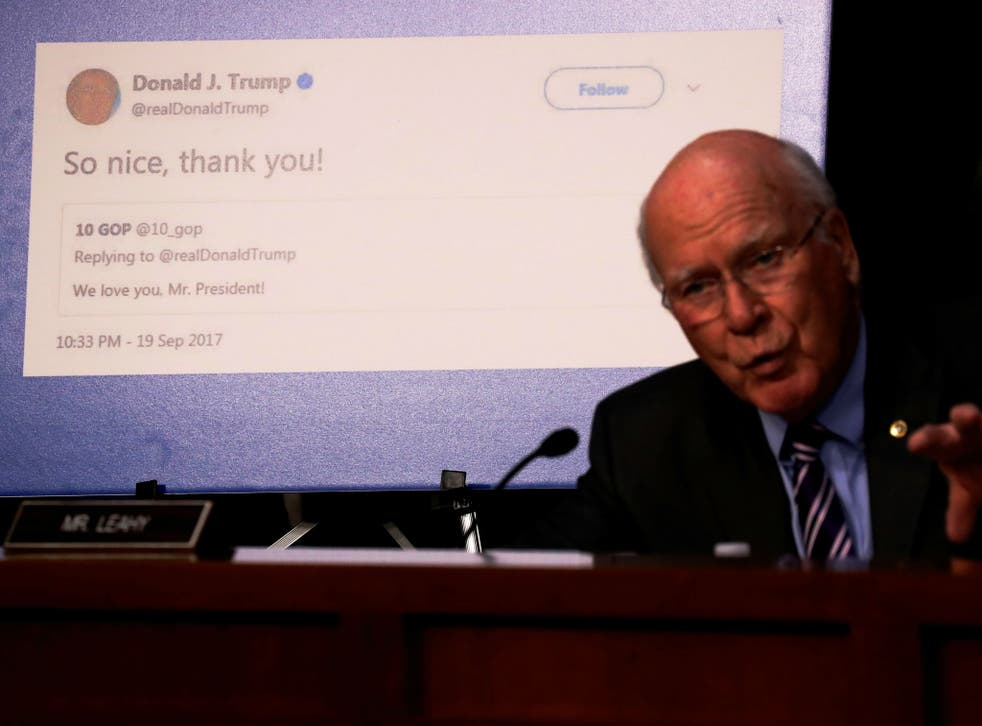 Senator Pat Leahy shows a re-tweet by President Trump of an alleged Russian troll account as representatives of Twitter, Facebook and Google testify before on Capitol Hill on October 31, 2017