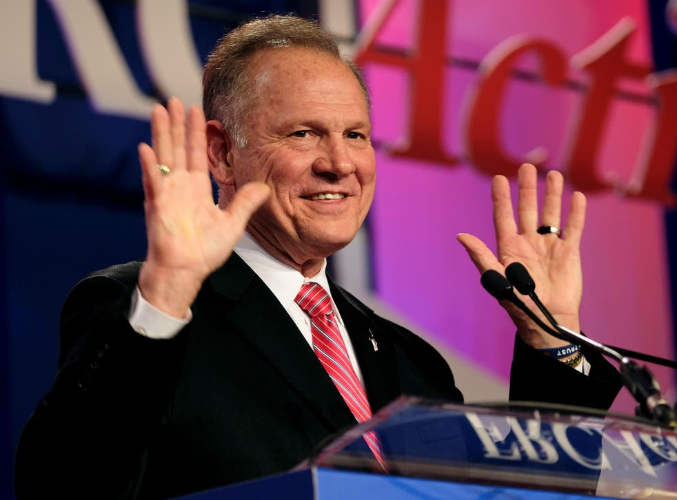Moore, here speaking at the Values Voter Summit of the Family Research Council, faces allegations of pursuing relationships with underage women