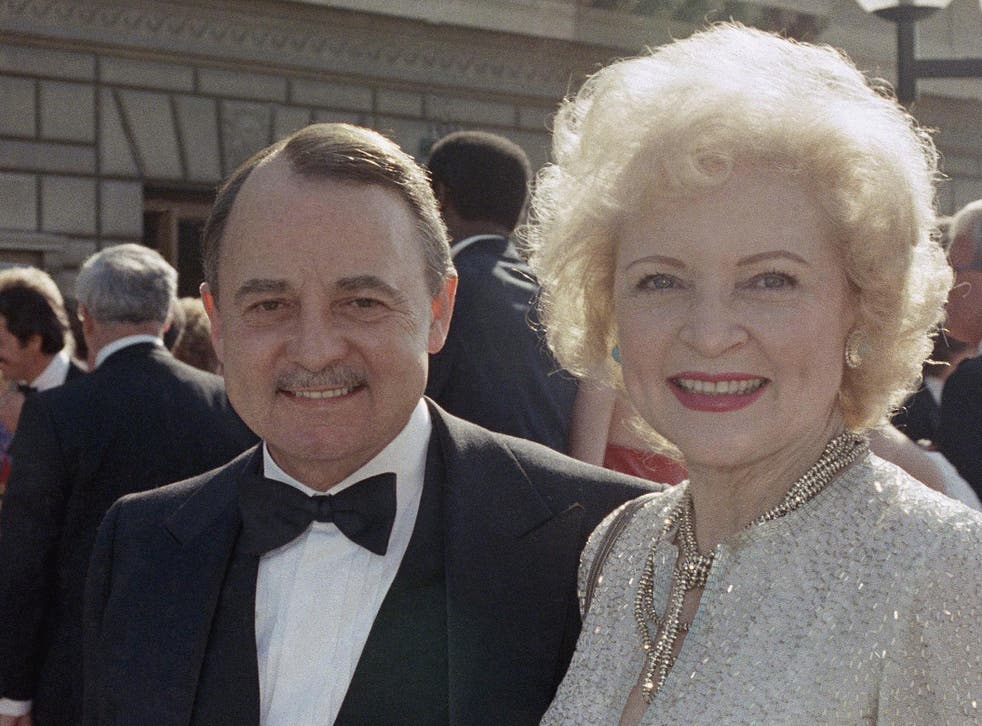 John Hillerman pictured with Betty White the 1985 Emmy Awards in Pasadena, California