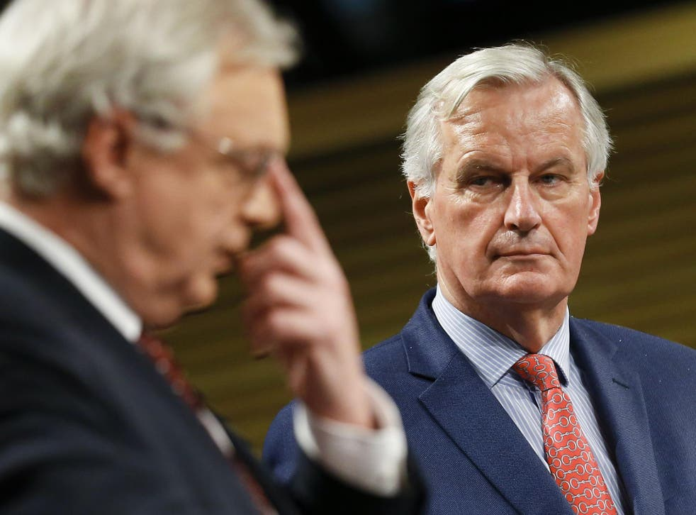 Michel Barnier watches Brexit Secretary David Davis at a meeting earlier this year