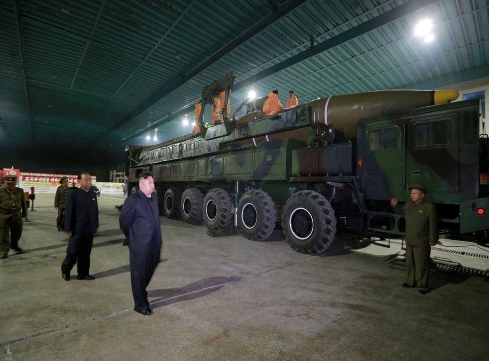 North Korean leader Kim Jong-un inspects an intercontinental ballistic missile