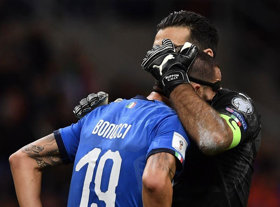 Gianluigi Buffon consoles Leonardo Bonucci after the final whistle