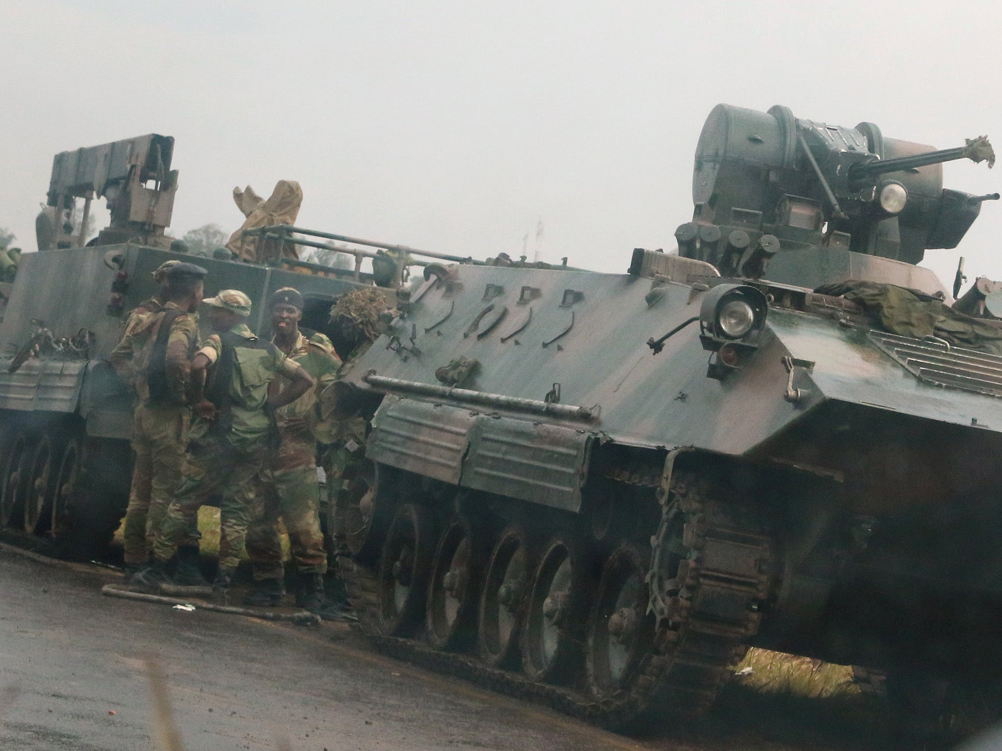 Robert Mugabe's party accuses army of treason as tanks take to streets of Zimbabwe