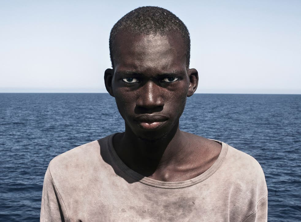 Spanish freelance photographer and journalist Cesar Dezfuli's photo of migrant Amadou Sumaila