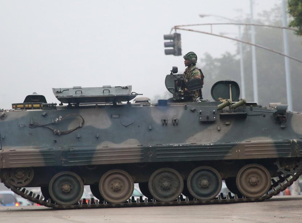 An army tanker blocks the main road to Parliament building in Harare after the Zimbabwe National Army (ZNA) has reportedly taken control over the government of President Robert Mugabe