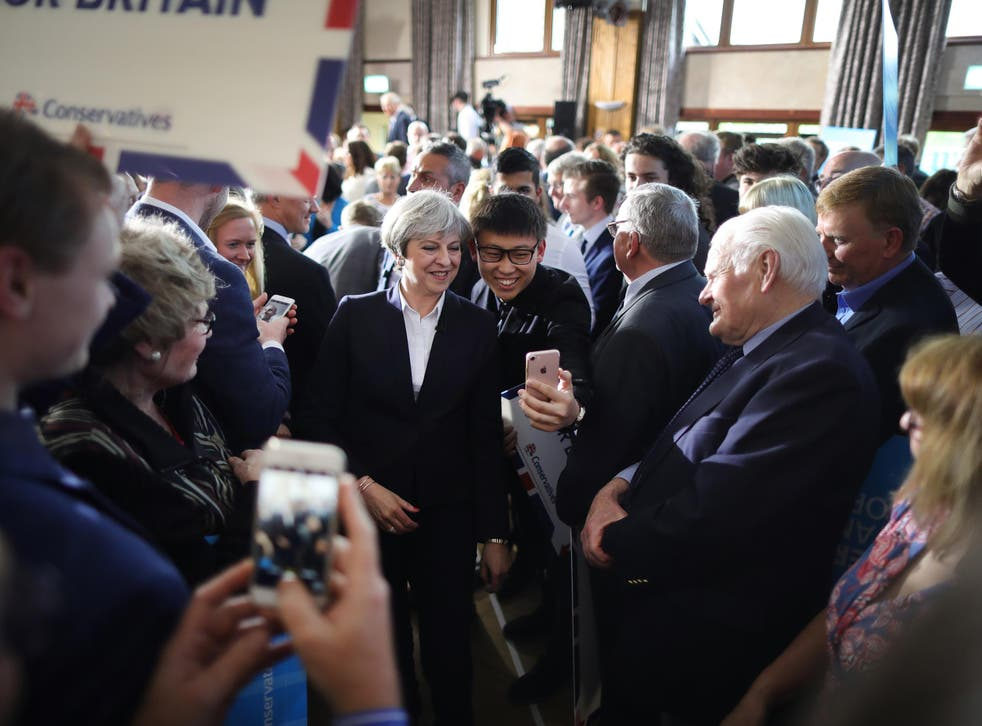 Even Theresa May gets stopped by fans for selfies