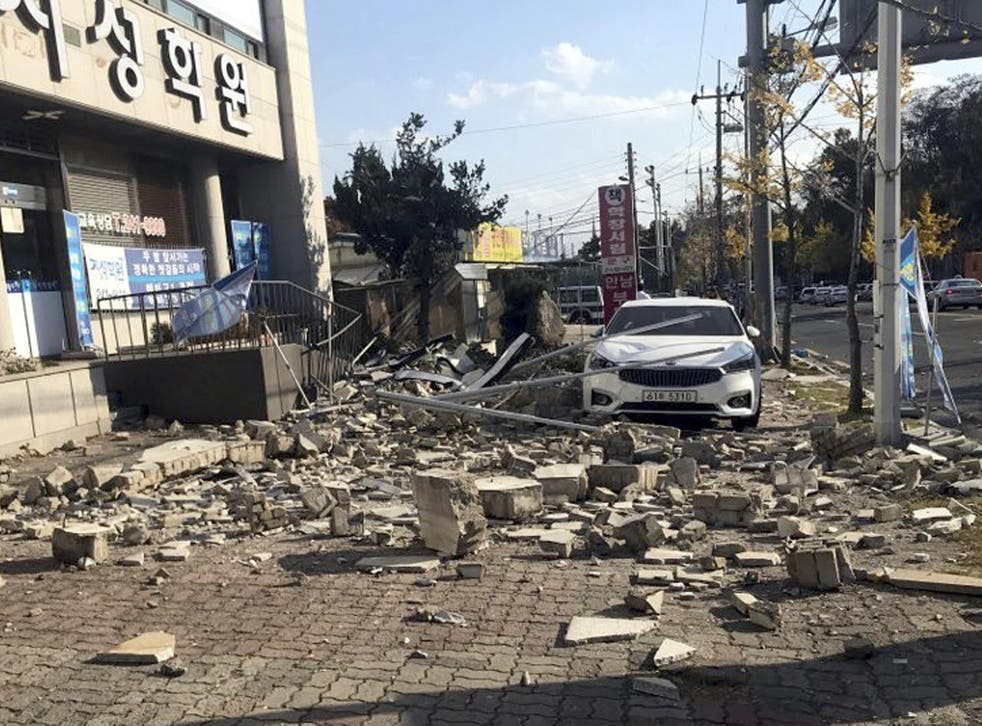 Debris from a collapsed wall is scattered in front of a shop after an earthquake in Pohang