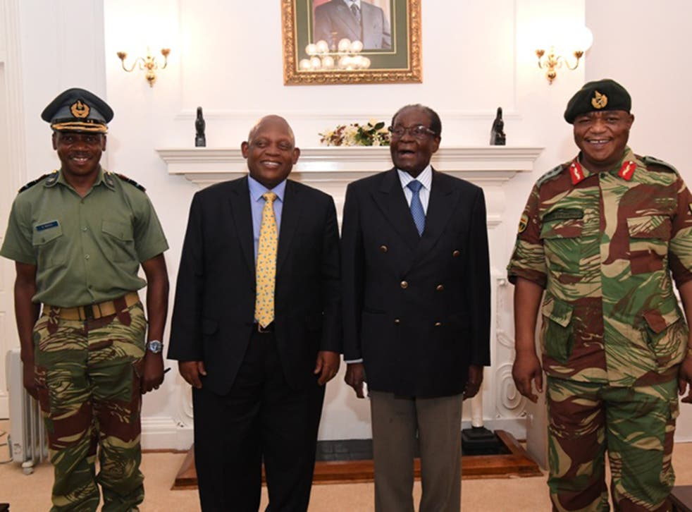 Robert Mugabe met with army commander General Constantino Chiwenga, right