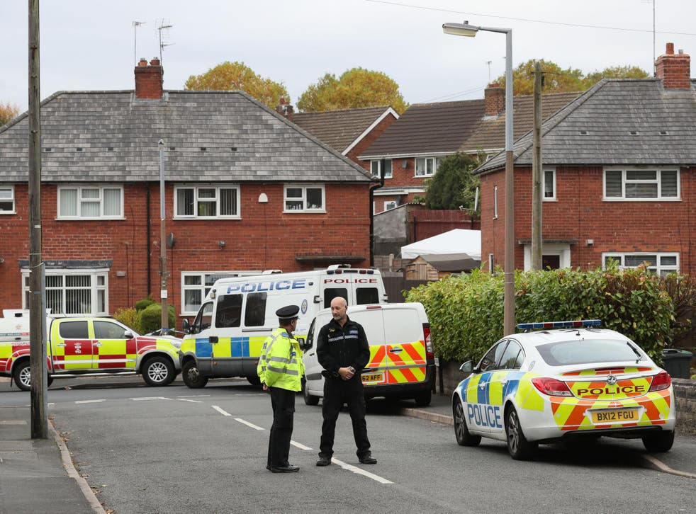 Police at the scene in Holland Road, Hamstead, Birmingham, after a boy and a girl died in a house fire