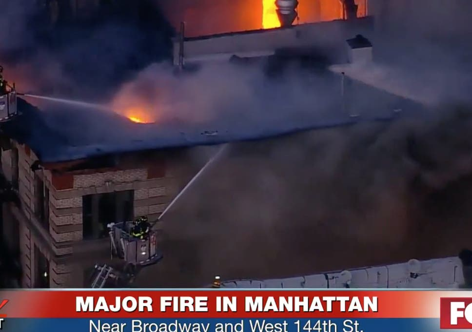 manhattan fire huge blaze breaks out at new york apartment block as