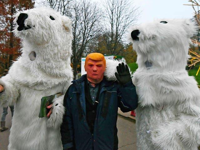 Activists protest President Trump's regressive attitude to climate change