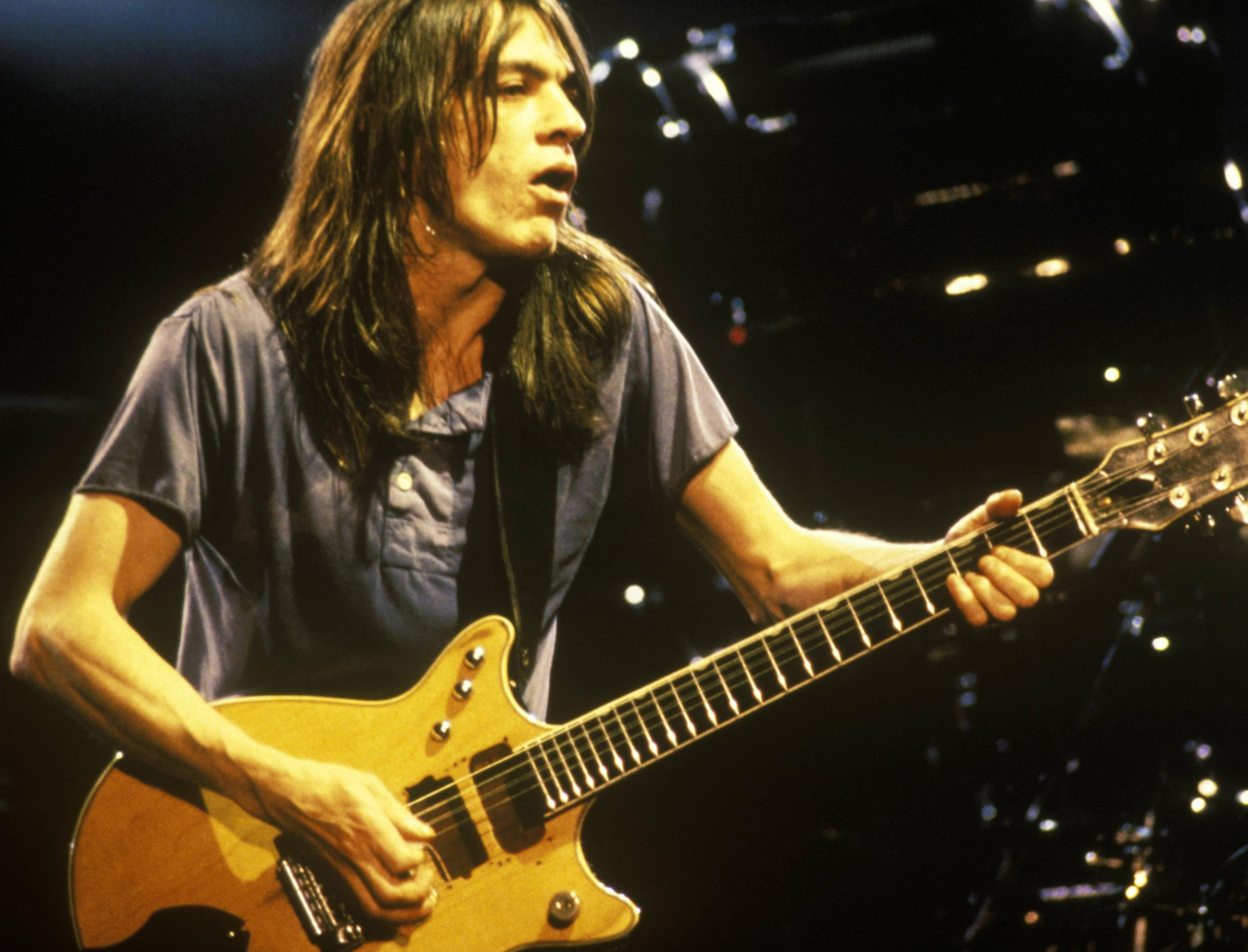 malcolm young guitarist behind some of the most legendary songs in rock the independent