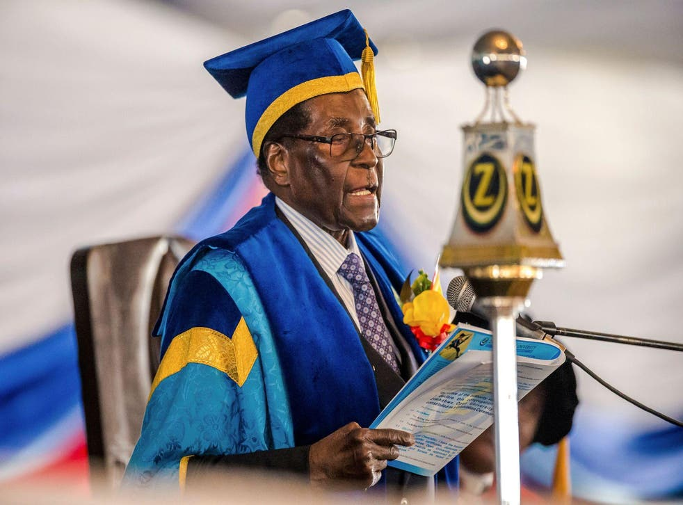 Zimbabwe's President Robert Mugabe delivers a speech during a graduation ceremony at the Zimbabwe Open University in Harare, where he presides as the Chancellor on November 17, 2017
