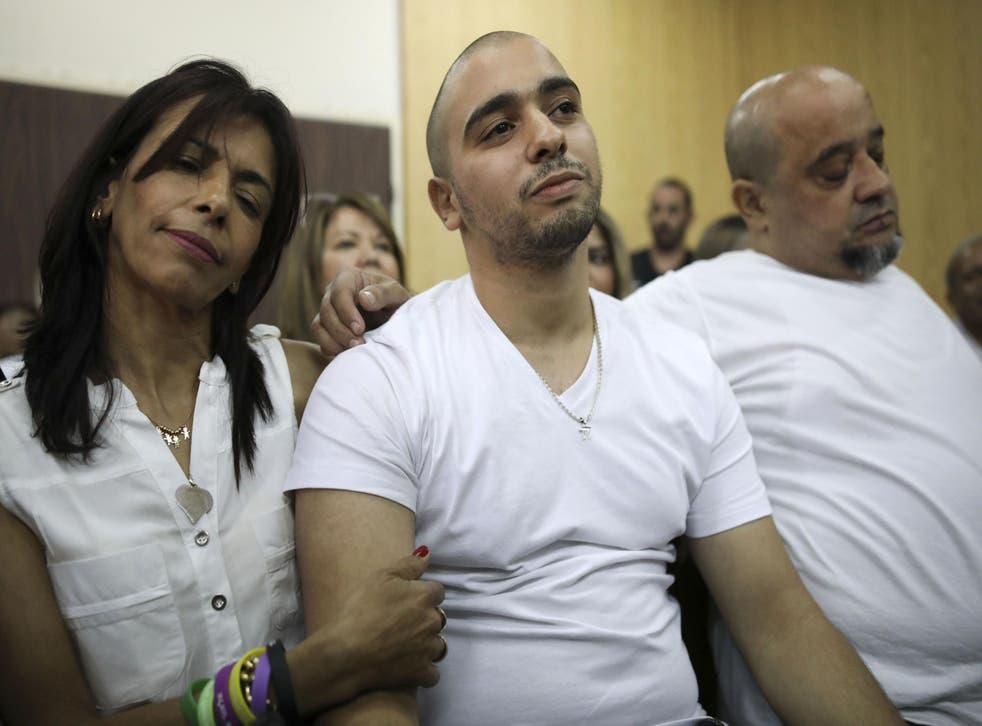 Azaria in court in July with his mother Oshra – civil rights campaigners claim his sentence is less than Palestnian children get for throwing stones