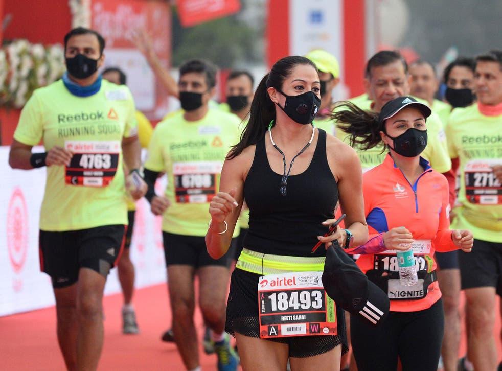 Men and women wear face mask as they take part in the Airtel Delhi Half Marathon 2017 in New Delhi