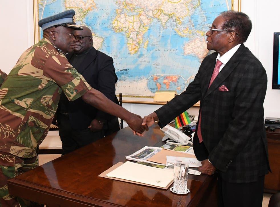 Robert Mugabe greeting the Air Force of Zimbabwe Commander Perence Shiri