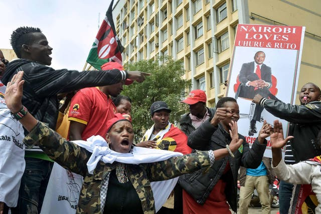 Supporters of President Uhuru Kenyatta celebrate in Nairobi after two petitions to overturn the election results were dismissed