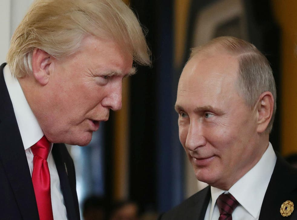 US President Donald Trump chats with Russia's President Vladimir Putin at a summit in Vietnam