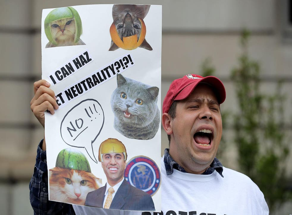 Proponents of net neutrality protest against Federal Communication Commission Chairman Ajit Pai outside the American Enterprise Institute before his arrival May 5, 2017 in Washington, DC