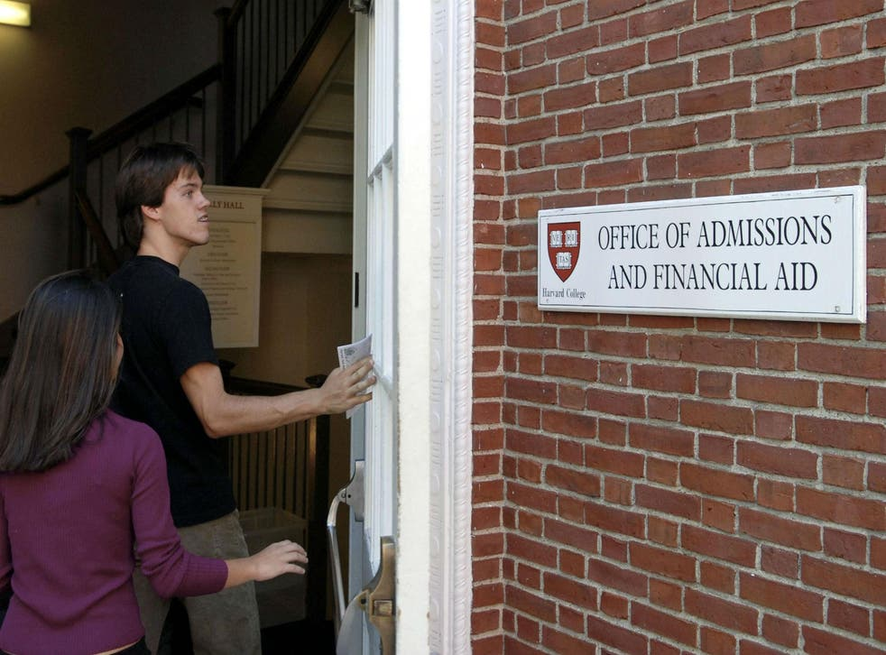 Students enter the Admissions Building on the campus of Harvard University in Cambridge, Massachusetts (Photo by Glen Cooper/Getty Images)