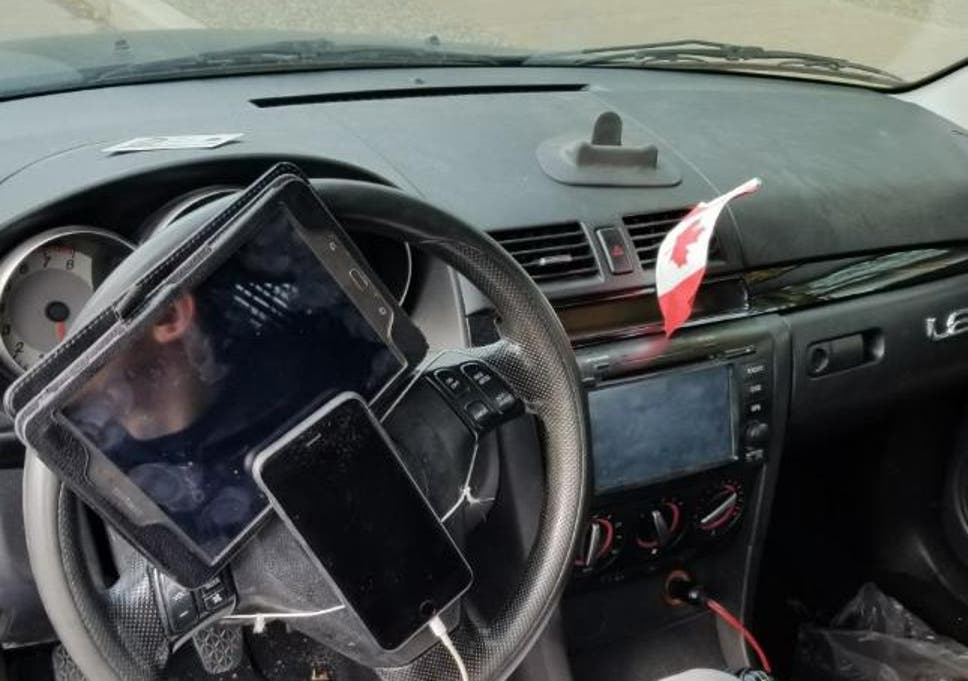 Traffic police fined a driver in Vancouver after he was found to have his phone and tablet strapped to his steering wheel.