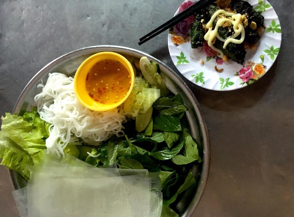 Bo la lot is minced beef wrapped in wild betel leaf