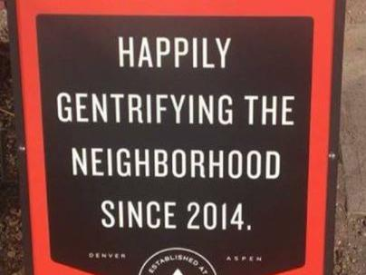 Coffee shop apologises for 'happily gentrifying the neighbourhood' sign