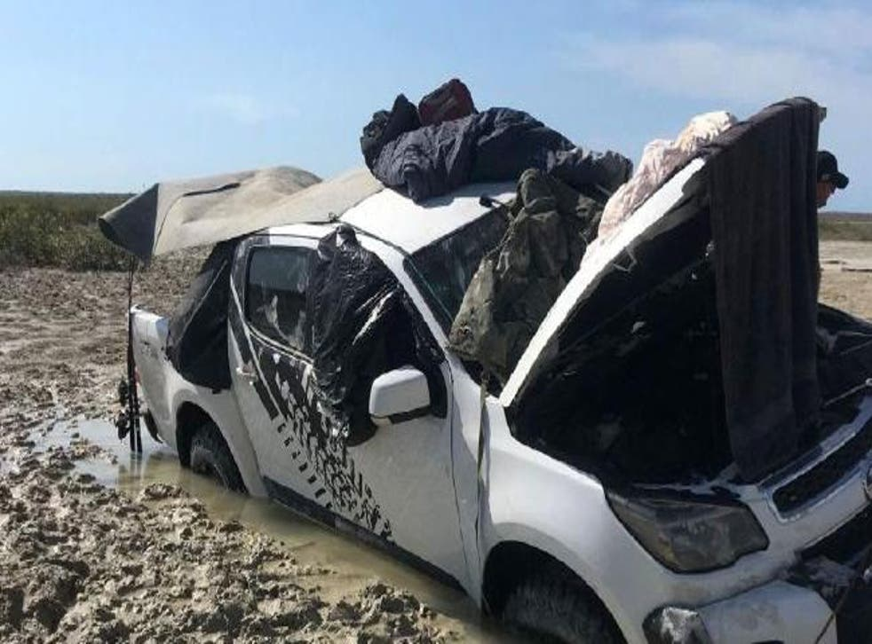Two fishermen left stranded after their car became trapped in a bog on Friday