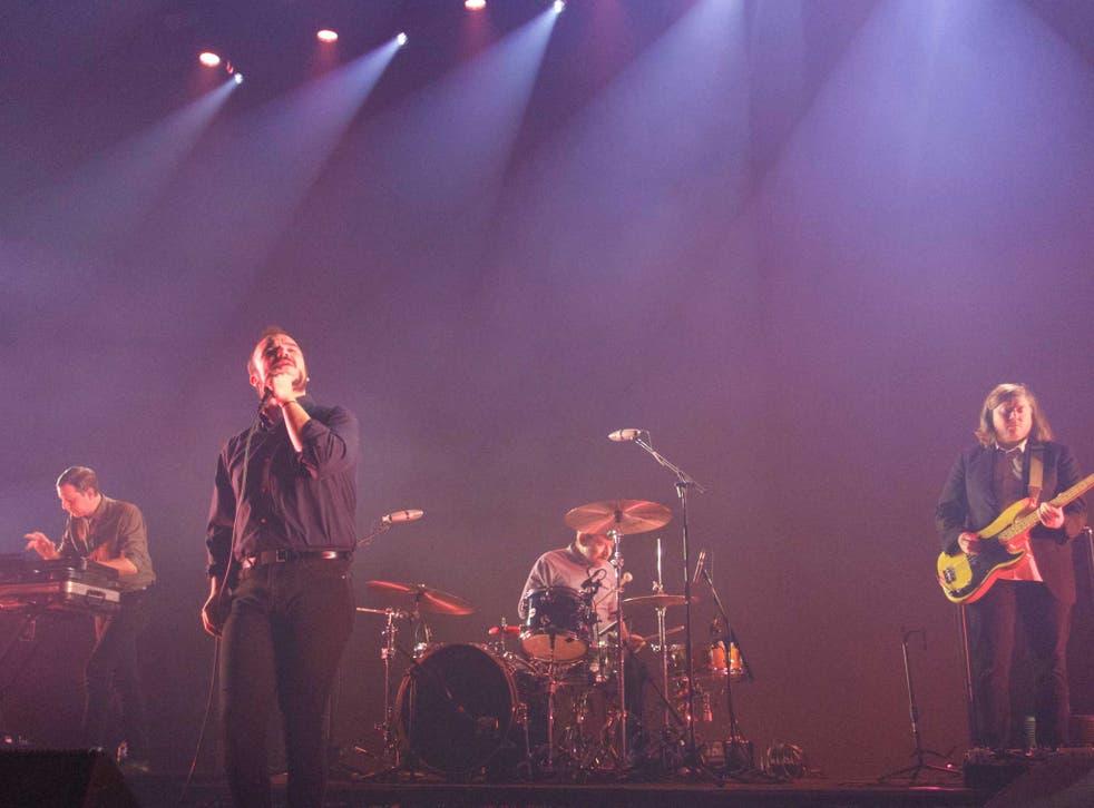 Future Islands performing at Brixton Academy