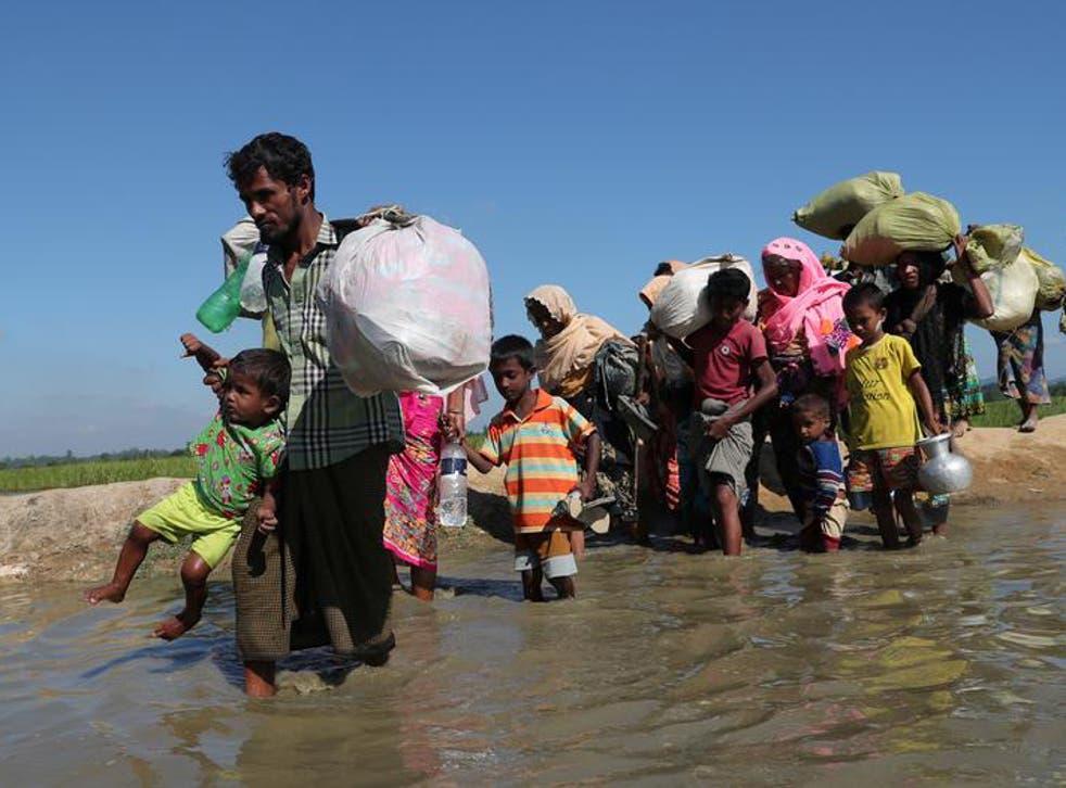 Rohingya refugees head for a camp after crossing the border in Anjuman Para near Cox's Bazar, Bangladesh