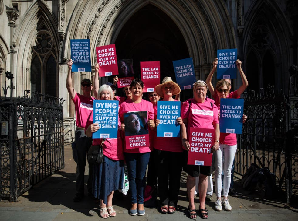 Campaign group Dignity in Dying outside the Royal Courts of Justice