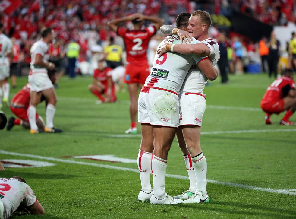 Ryan Hall (L) and Kevin Brown celebrate after the final whistle in Auckland