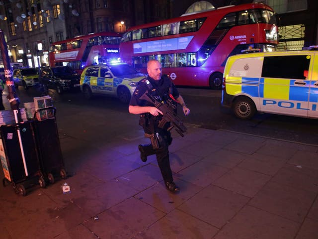 An armed policeman runs down Oxford Street in central London on November 24, 2017, as police responded to an incident