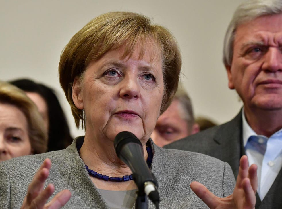 Angela Merkel's fourth term appears more secure as the leader of Germany's SDP, Martin Schulz, threw his support behind a 'grand coalition'