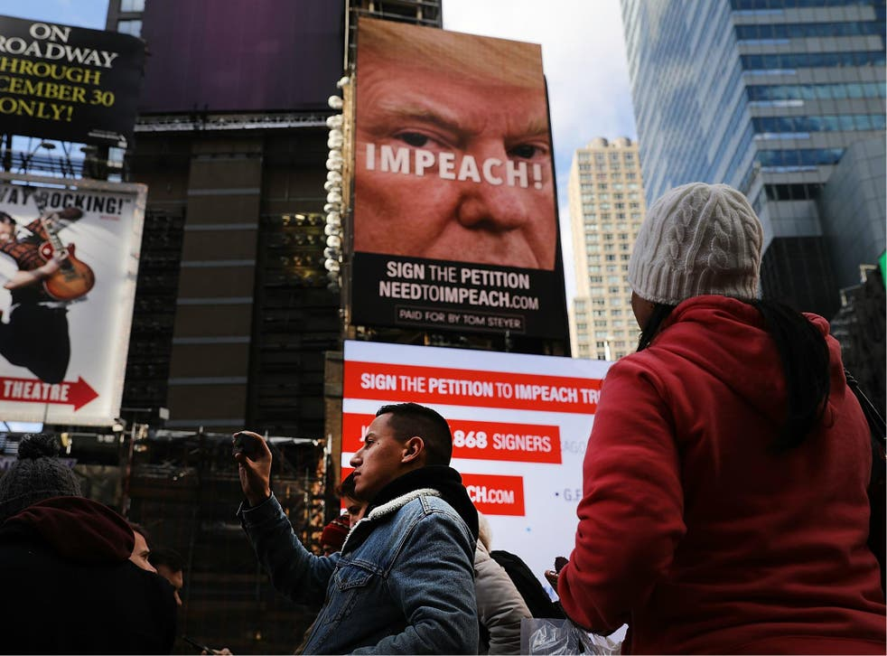A billboard in Times Square, funded by Tom Steyer, calls for the impeachment of President Donald Trump on 20 November 2017 in New York City.