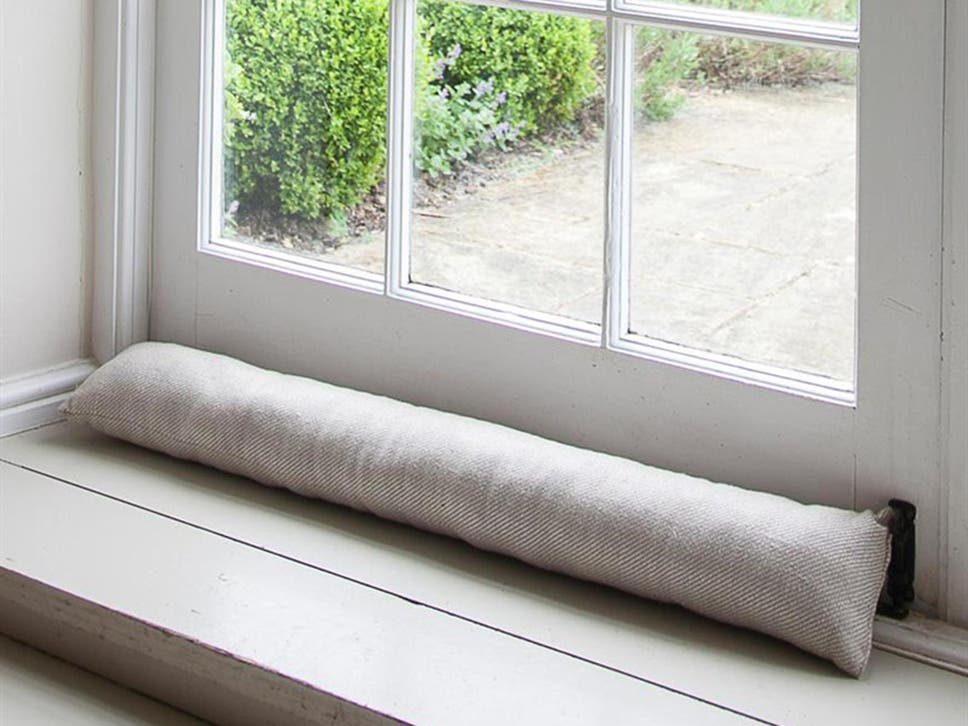 These Weighted Stoppers Will Keep The Cold Out While Adding A Splash Of  Style To Your Doorway