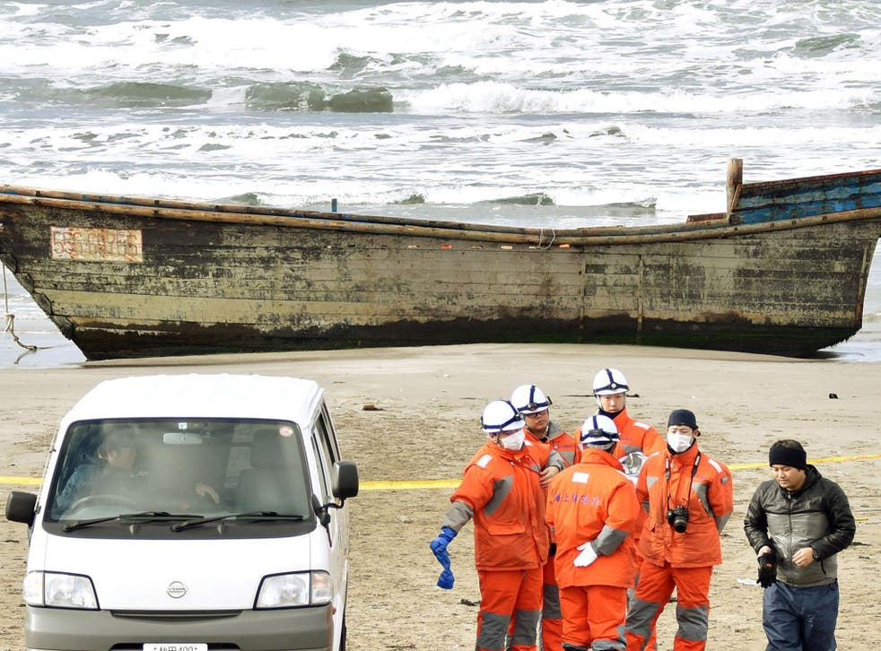 The wooden boat, which drifted ashore with eight partially skeletal bodies,was found by the Japan Coast Guard in Oga, Akita Prefecture