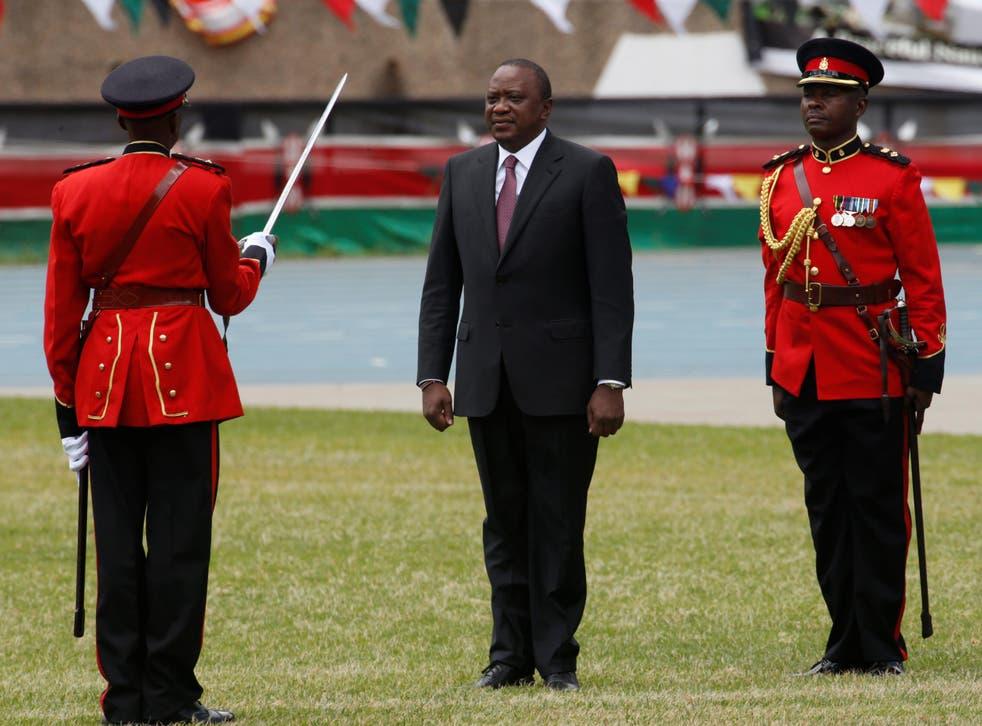 Kenya's President Uhuru Kenyatta takes oath of office during inauguration ceremony at Kasarani Stadium in Nairobi