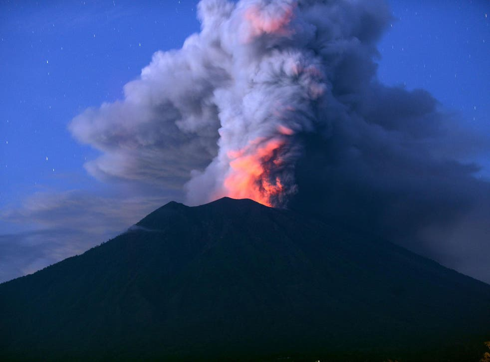 Mount Agung has stranded tens of thousands of tourists as it spits ash 4,000m (2.5 miles) into the air