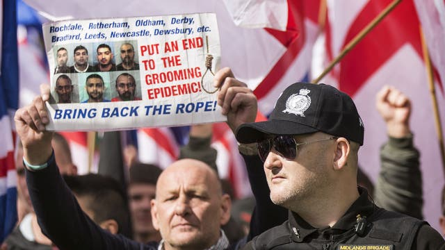 A demonstrator with 'Bring back the rope!' sign during a Britain First Rotherham demonstration in 2015