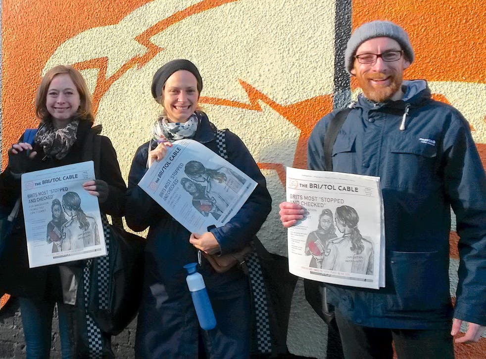 Bristol Cable members distribute an issue of the paper featuring an investigation into immigration checks