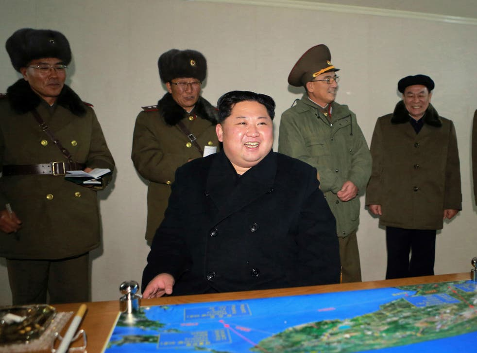 In this photo provided on Thursday, Nov. 30, 2017, by the North Korean government, North Korean leader Kim Jong Un inspects an intercontinental ballistic missile test in North Korea on Wednesday, Nov. 29