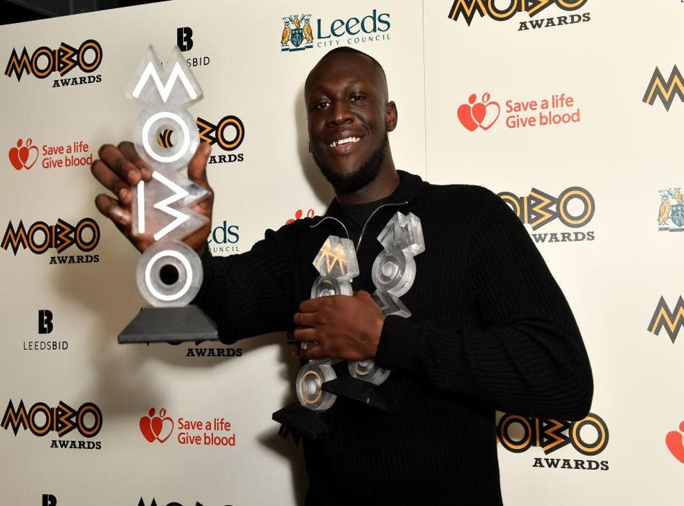 Stormzy with his three MOBO Awards at the 2017 ceremony in Leeds