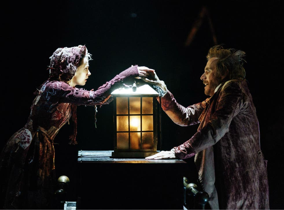 Melissa Allan (Little Fan) and Rhys Ifans (Ebenezer Scrooge) in 'A Christmas Carol' at The Old Vic