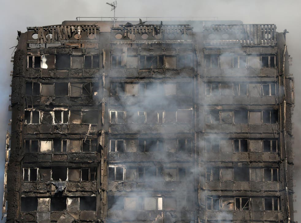 Smoke billows from the Grenfell Tower in Kensington, where 71 people were killed